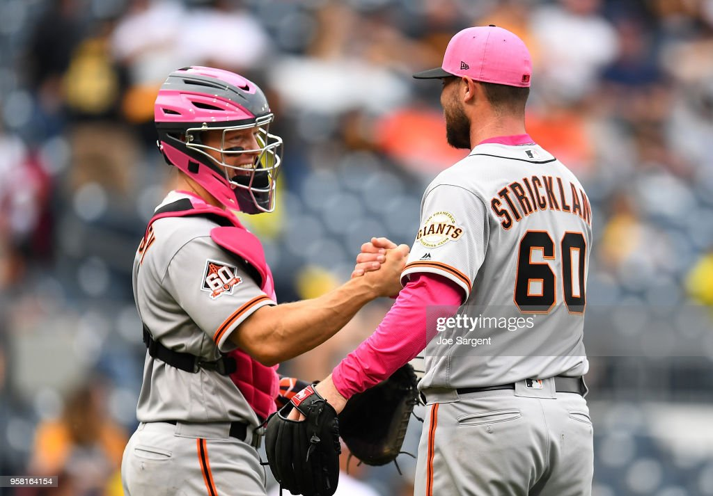 Hunter Strickland #60 celebrates with Nick Hundley #5 of the San Francisco Giants after a 5-0 win over the Pittsburgh Pirates at PNC Park on May 13, 2018 in Pittsburgh, Pennsylvania.