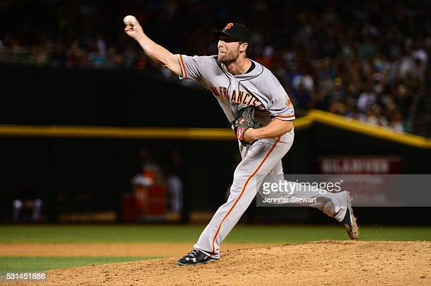 Hunter Strickland of the San Francisco Giants delivers a pitch during the eighth inning against the Arizona Diamondbacks at Chase Field on May 14...