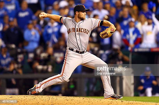 Hunter Strickland of the San Francisco Giants pitches in the ninth inning against the Kansas City Royals during Game One of the 2014 World Series at...