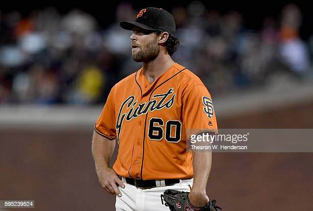 Hunter Strickland of the San Francisco Giants stands on the mound and waits for manager Bruce Bochy to come take him out of the game against the New...