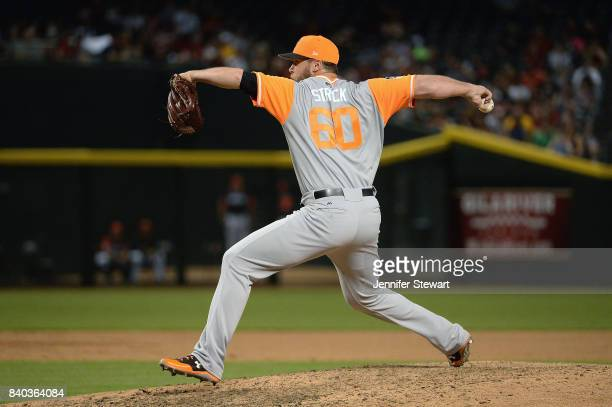 Hunter Strickland of the San Francisco Giants wearing a nicknamebearing jersey delivers a pitch in the MLB game against the Arizona Diamondbacks at...