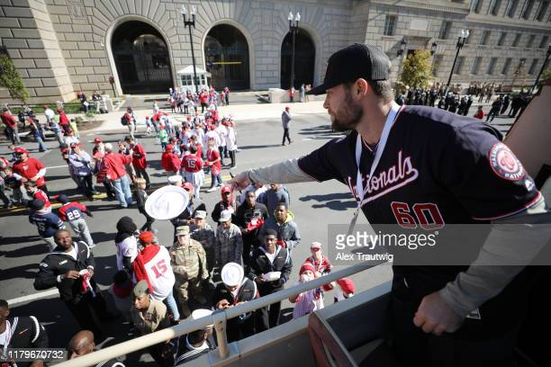 Hunter Strickland of the Washington Nationals signs autographs before the 2019 World Series victory parade on Saturday November 2 2019 in Washington...