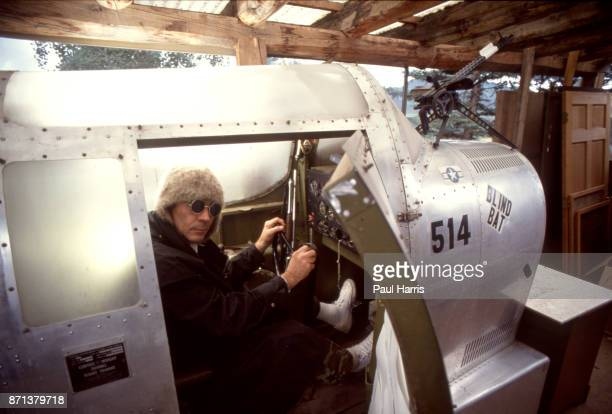 Hunter Thompson aka Hunter S Thompson aka Gonzo Journalist at his ranch sitting in his Link Trainer with a pistol on October 12 1990 in Woody Creek...