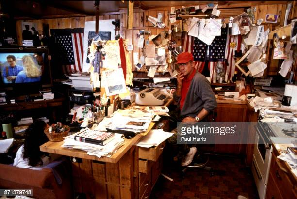 Hunter Thompson aka Hunter S Thompson aka Gonzo Journalist at his ranch sitting in his kitchen which he also used as an office on October 12 1990 in...