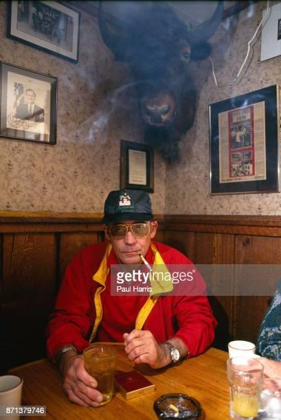 Hunter Thompson aka Hunter S Thompson aka Gonzo Journalist sitting in his favorite corner of The Woody Creek Tavern a local bar close to his own home...