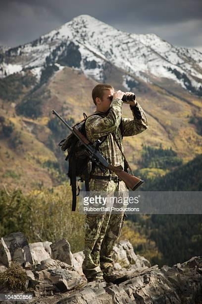 hunter using binoculars to spot prey - pic hunter stock pictures, royalty-free photos & images