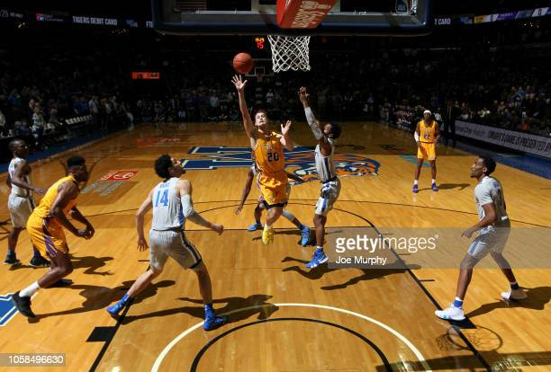 Hunter Vick of the Tennessee Tech Golden Eagles drives to the basket for a layup against Jeremiah Martin of the Memphis Tigers on November 6, 2018 at...