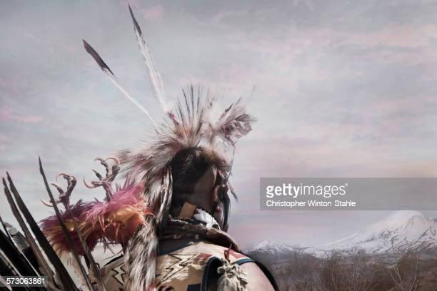 Hunter wearing traditional native headdress
