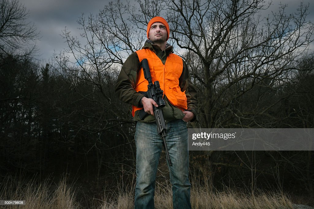 Hunter with a rifle : Stock Photo