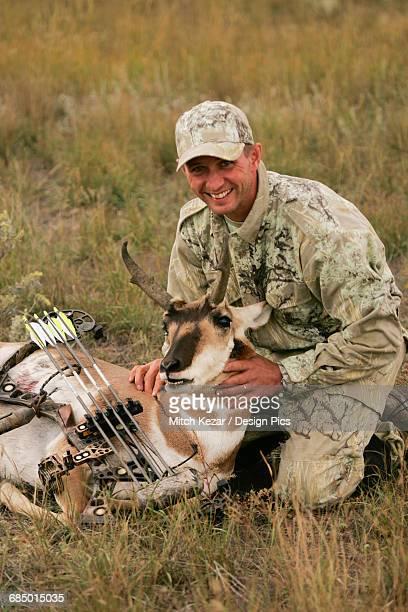 hunter with dead antelope - großwild stock-fotos und bilder