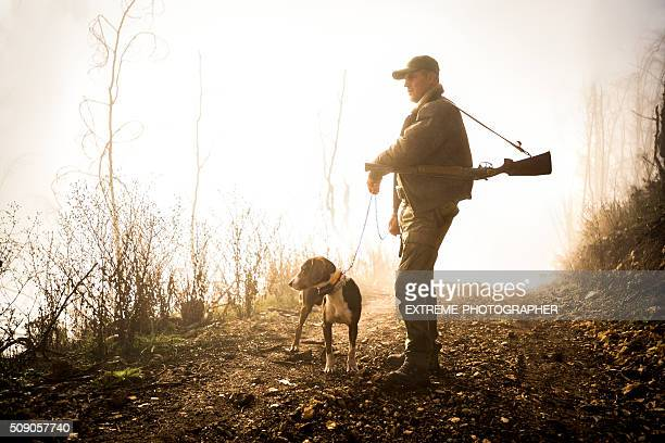 Hunter with dog in the forest