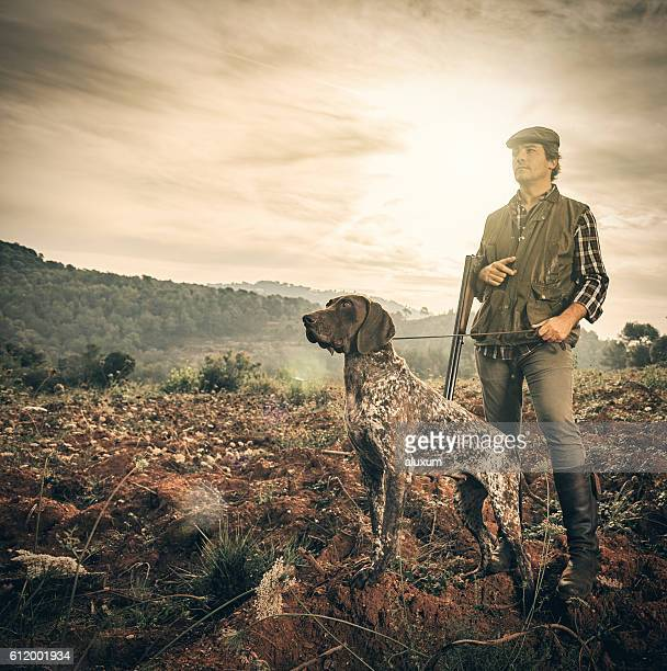 hunter with dog - german shorthaired pointer stock pictures, royalty-free photos & images