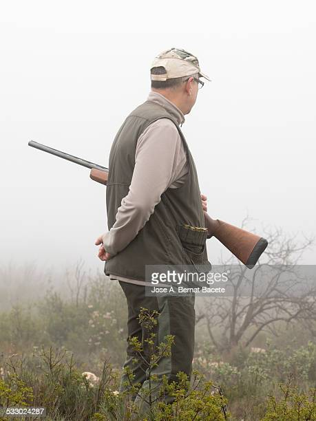 hunter with his weapon monitoring attentivly - lingering stock pictures, royalty-free photos & images