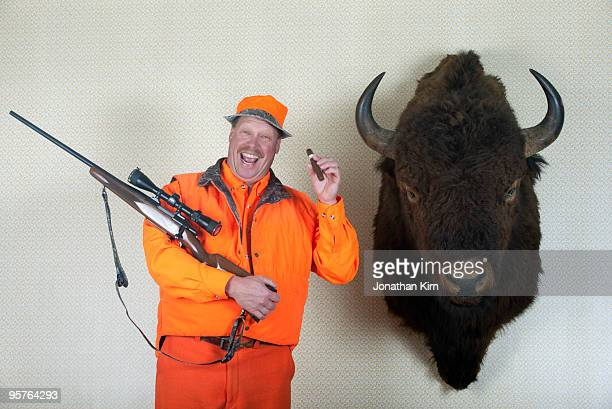 hunter with mounted buffalo head - preserved stock pictures, royalty-free photos & images