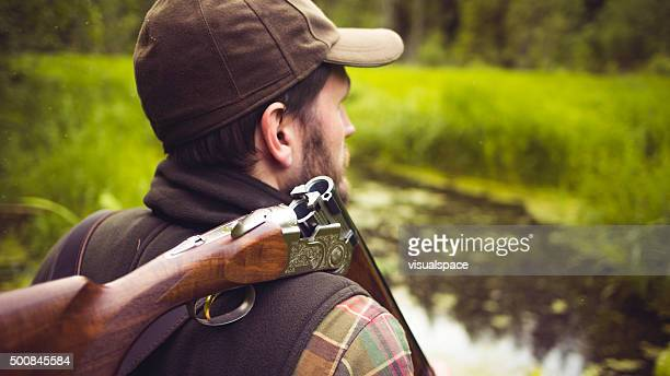 Hunter With Open Shotgun On Shoulder