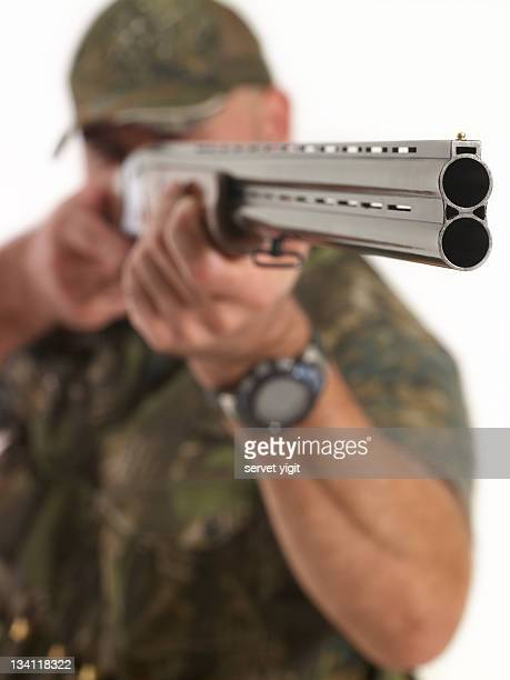 hunter with rifle - shotgun stock pictures, royalty-free photos & images