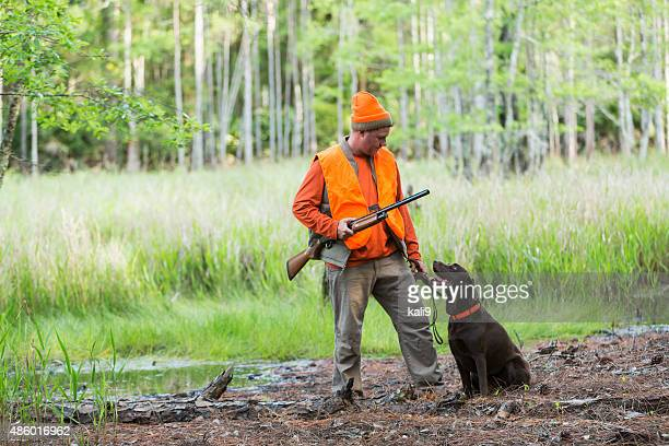 Hunter with shotgun and hunting dog