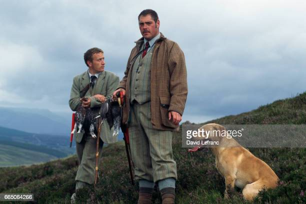 Hunters hold up their kill at the opening of grouse hunting season Images and captions taken from the book La Magie du Whisky   Location Newtonmore...