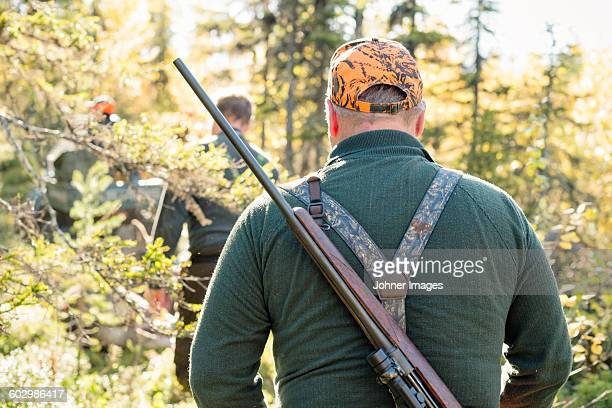 Hunters in forest