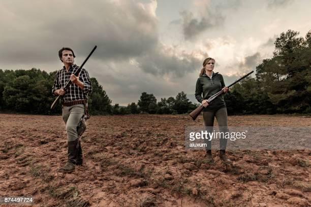 Hunters in plowed field