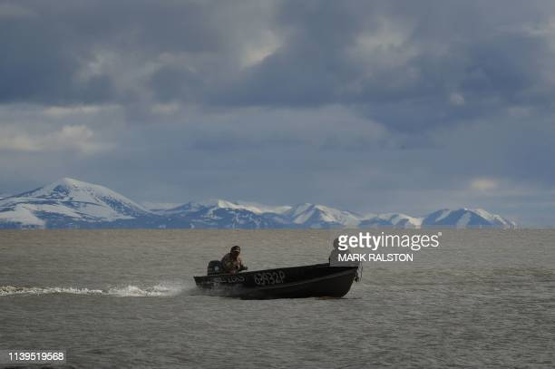 Hunters return from a trip along the coast of the Bering Sea near the climate change affected Yupik Eskimo village of Quinhagak on the Yukon Delta in...