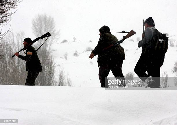 Hunters search for patridges in the mountains of the eastern Turkish city of Tunceli on January 30 2010 Partridges are one of the most popular...