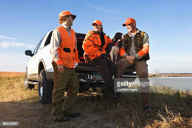hunters sitting on tailgate of truck - north dakota stock pictures, royalty-free photos & images