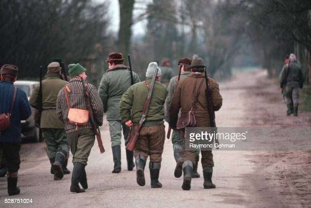 hunters walking down road - bialowieza forest stock pictures, royalty-free photos & images