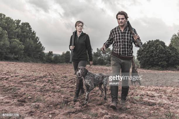 hunters with german shorthaired pointer - hunting stock pictures, royalty-free photos & images