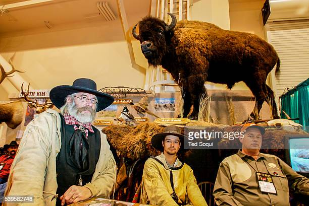 Hunters with taxidermied Buffalo The Safari Hunters Club convention 2004 held in Reno Nevada The annual event features the latest in hunting...
