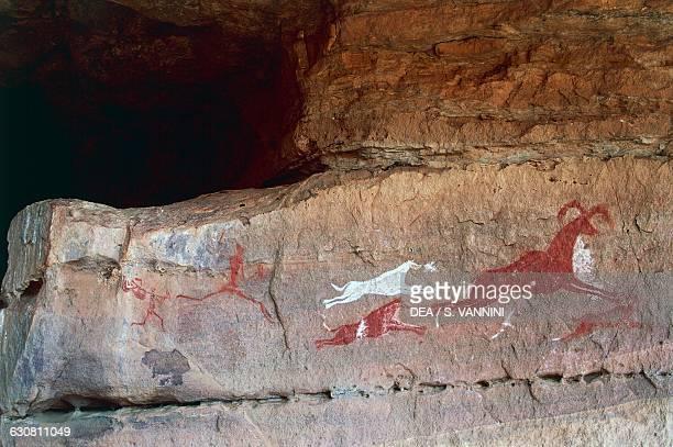 Huntig scene cave paintings Tadrart Acacus Libya