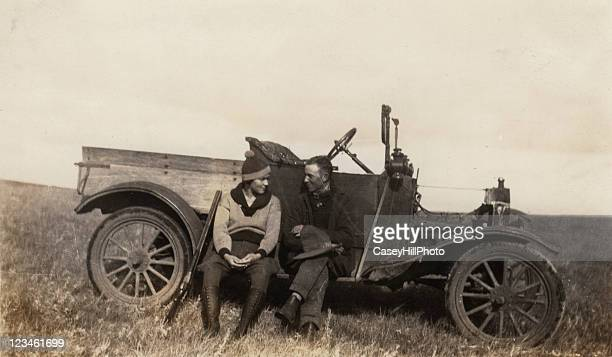 hunting couple - 1920 car stock photos and pictures