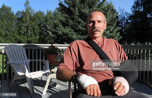 Hunting guide Jim Tuttle pictured August 25 was mauled by female Arctic grizzly bear known as Buddy while he was walking alone between his campsite...
