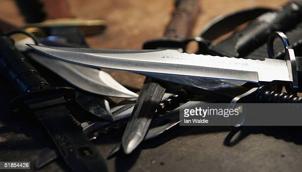 Hunting knifes are displayed at a film and television prop company December 13 2004 in London England Families of stabbing victims have called on the...