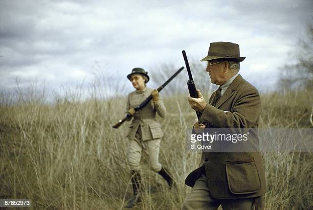 Olin Kennels owners Evelyn Olin and John Olin hunting for pheasant at Nilo Farms Cover Alton IL 3/10/1958 CREDIT Dan Weiner