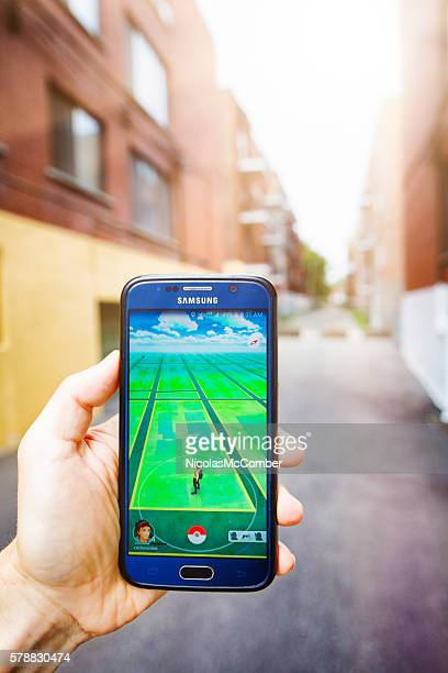 Hunting Pokemon with mobile phone personal perspective urban vertical