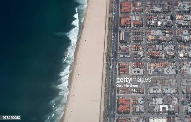 Huntington Beach and the Pacific Ocean are seen from an airplane landing at John Wayne Airport on June 15 2018 in Costa Mesa California