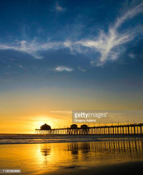 huntington beach pier at sunset - huntington beach stock pictures, royalty-free photos & images
