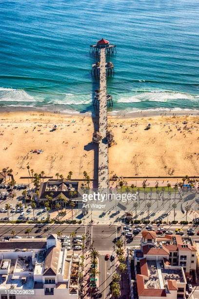huntington beach pier from above - orange county crowded beaches stock pictures, royalty-free photos & images