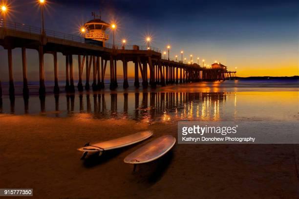 Huntington Beach Pier - Surfboards on Sand at Sunset