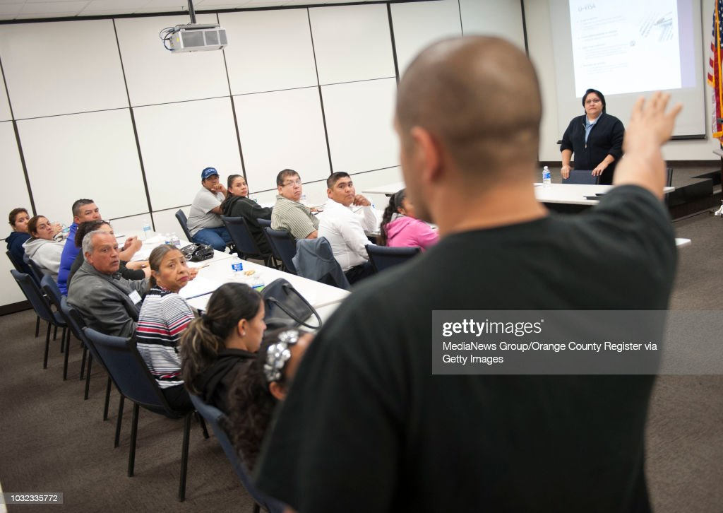 Huntington Beach Police Officer Rafael Mena talks to