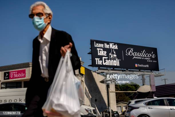 Huntington Beach restaurant Basilicos Pasta e Vino has put up an anti-mask billboard with a nod to the film, The Godfather, along La Cienega...