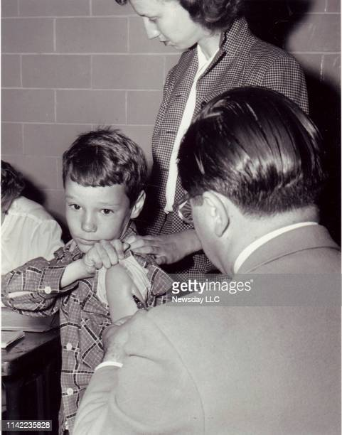Wallace F. Pickard gets the polio vaccine from Dr. Joseph Palmieri at the Village Green School in Huntington, New York on April 27, 1954.
