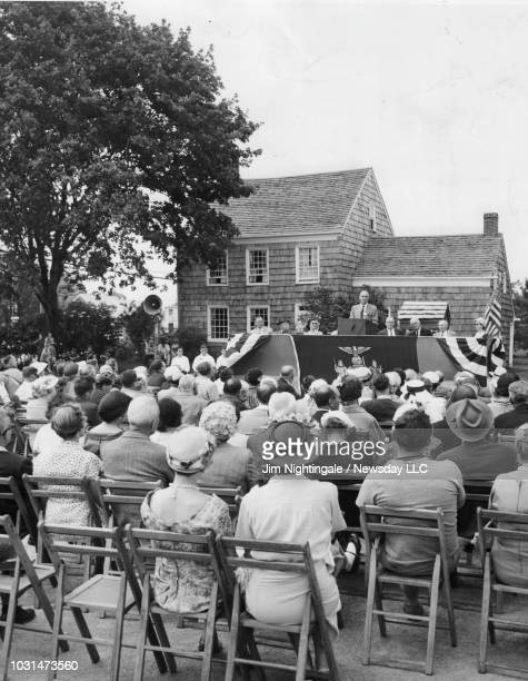 Huntington Station, N.Y.: New York State Historian Albert Corey of Albany, New York speaks to a crowd assembled for the official opening of the Walt...
