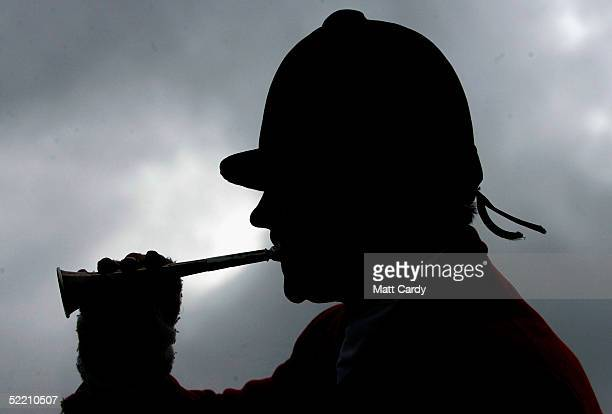 A huntsman blows his horn as the Avon Vale hunt join together for the final day of legal hunting with dogs in England and Wales February 17 2005 in...