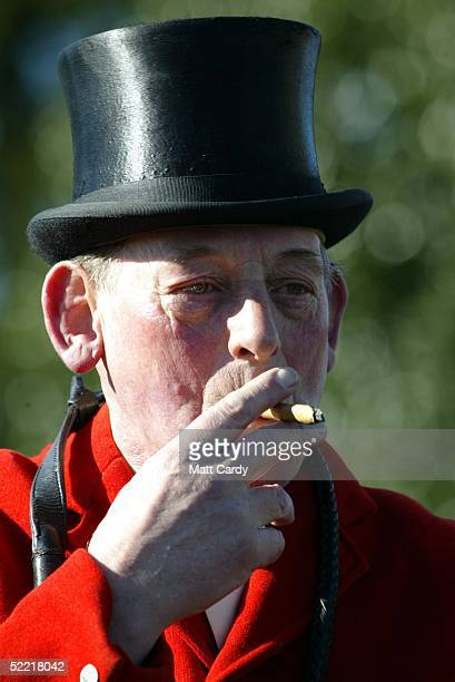 A huntsman smokes a cigar before riding out at the Avon Vale Hunt at Monk's Park on February 19 2005 near Corsham Wiltshire England Some hunts are...