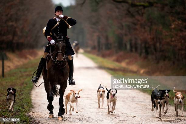 TOPSHOT HuntsmanPhilippe Prioux from the 'Rallye Tempete' rides his horse during a hunting with hounds on December 23 2017 in the forest near...