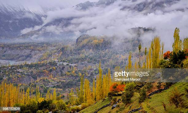 hunza in fog - gilgit baltistan stock photos and pictures