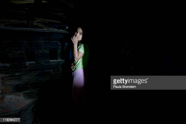 Huong, age 14, who is Autistic hides in a dark corner March 10 in Cam Lo, in Quang Tri province, Vietnam. Huong's family says she suffers from the...