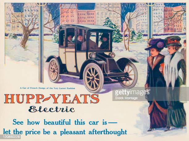 """A HuppYeats electric car on a snow covered city street is shown in a magazine advertisement from 1911 The ad states """"A Car of French Design of the..."""